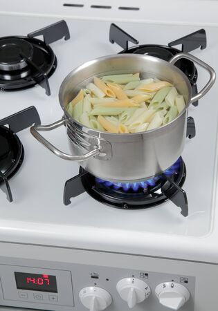 upperdeck view: Pasta in a pot on the gas stove.
