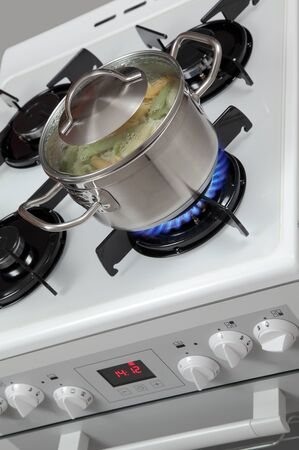 Pasta in a pot on the gas stove. photo