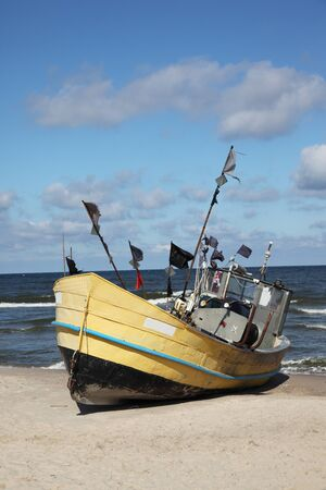 Fishing boat on Baltic Beach in Niechorze, Poland Stock Photo - 10425486