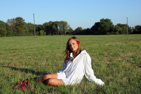 Young sexy woman sitting on the grass Stock Photo - 10599409