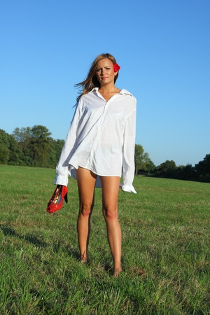 Young sexy woman walking on the grass Stock Photo - 10599406