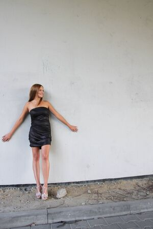 Young sexy woman on the wall background Stock Photo - 10599404