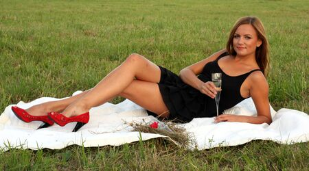 Girl drinking champagne in the park Stock Photo - 10599407