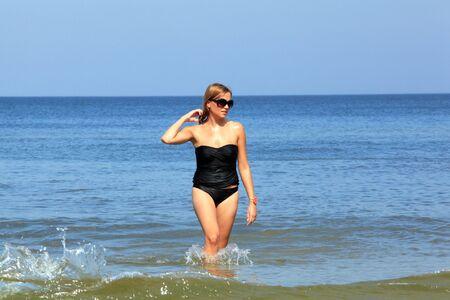 Beautiful young woman walking in the Baltic sea. Stock Photo - 10632751