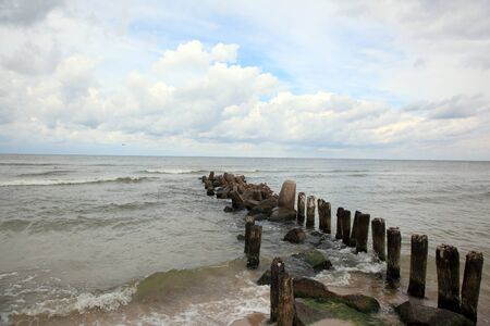 Groyne on shore of the Baltic Sea photo