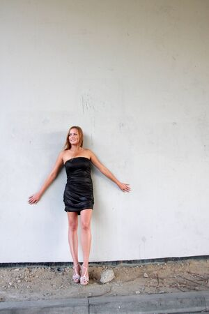 Young sexy woman on the wall background Stock Photo - 10685375