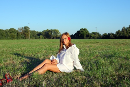 Young sexy woman sitting on the grass Stock Photo - 10685378