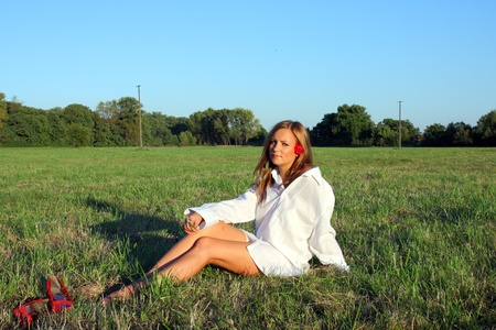 Young sexy woman sitting on the grass Stock Photo - 10685379