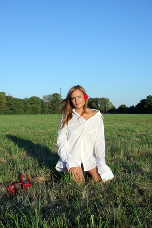 Young sexy woman sitting on the grass Stock Photo - 10685376