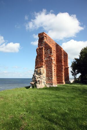 Ruins of gothic church from 1415th century located in Trzesacz near the Baltic Sea. Currently, remained only fragment of southern wall. Trzesacz village, Poland, Europe. photo