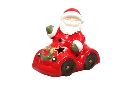 Santa Claus in a car figurine over white  Stock Photo - 11425487
