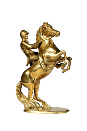 animal figurines: Brass statue of the jockey on a horse isolated over white with clipping path. Stock Photo