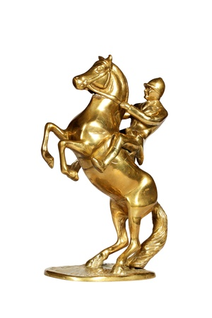 Brass statue of the jockey on a horse isolated over white with clipping path. Stock Photo