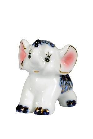 Ceramic elephant figurine isolated over white with clipping path. photo