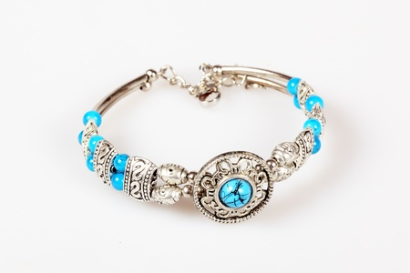 cut wrist: Silver bracelet with turquoise isolated over white Stock Photo