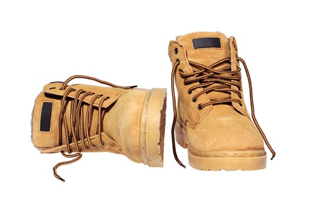 Hiking boots isolated over white photo