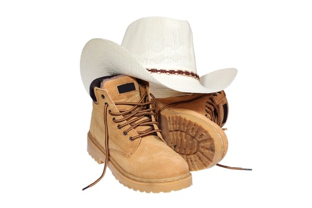 Hiking boots and hat isolated over white photo