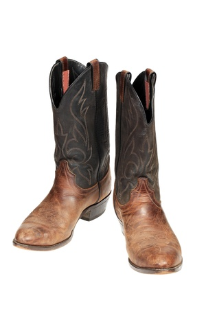 Cowboy boots isolated over white  photo