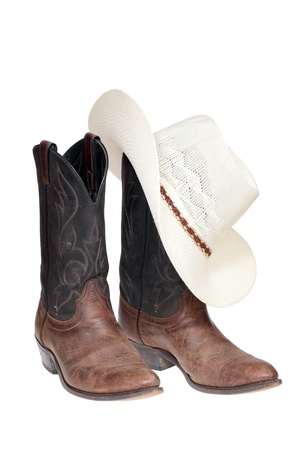 brown leather hat: Cowboy boots and hat isolated over white  Stock Photo