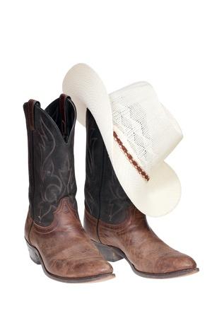 Cowboy-Stiefel und Hut über isolierte weiß Standard-Bild