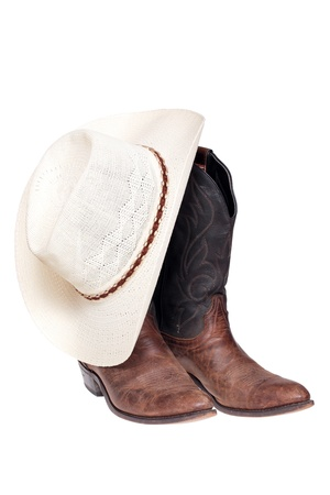 Cowboy boots and hat isolated over white  Stock Photo