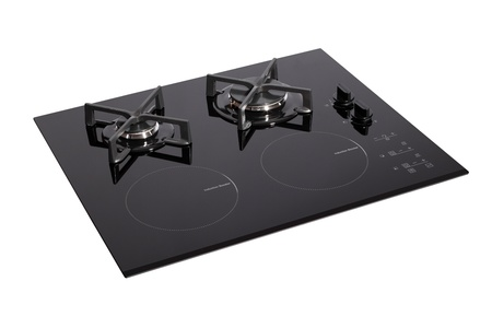 Black glass electric-gas hob isolated on white