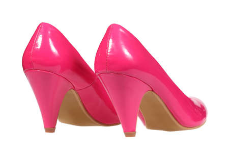 A pair of pink women s heel shoes isolated over white with clipping path  photo