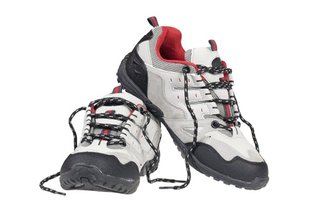 Sport trekking shoes isolated over white photo