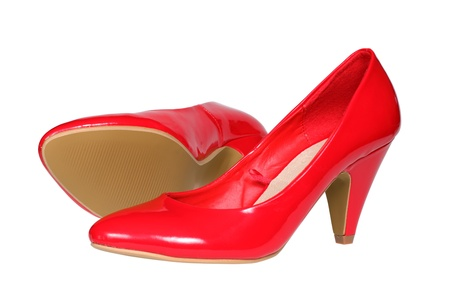 A pair of red women s heel shoes isolated over white  photo