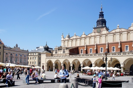 KRAKOW, POLAND - MAY 20: City Square with Old Market hall on May 20, 2012 in Krakow, Poland. City Square it is the largest medieval town square in Europe, visited by tourists from around the world. Stock Photo - 13744018