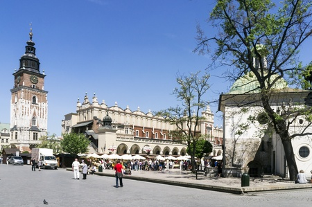KRAKOW, POLAND - MAY 20: City Square with the Town hall on May 20, 2012 in Krakow, Poland. Main City Square it is the largest medieval town square in Europe, visited by tourists from around the world. Stock Photo - 13744021