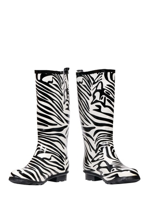 Zebra pattern rubber boots isolated over white  photo