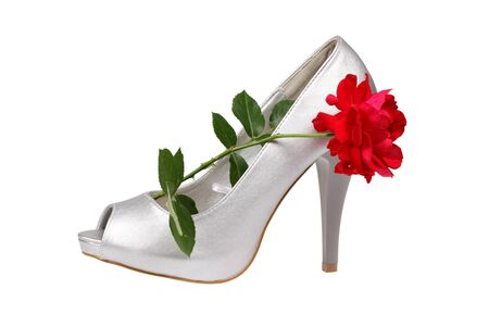 Silver women s heel shoe with red rose isolated over white with clipping path  photo