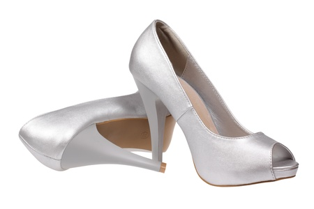 A pair of silver women s heel shoes with clipping path  photo