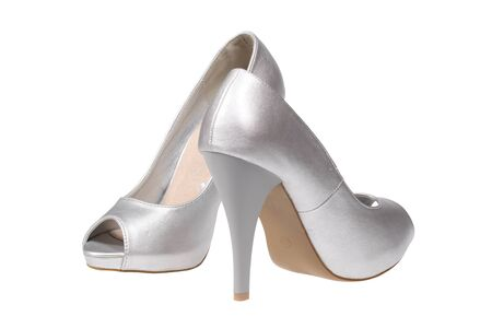 A pair of silver women s heel shoes isolated over white  photo