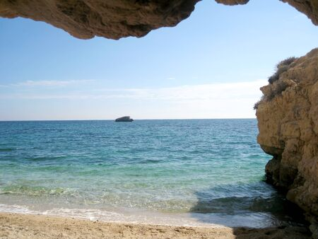 Paradise beach, turquoise sea and cave in Sardegna, Italy photo