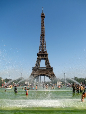 Record-breaking heat wave in Paris that make people cool in the fountain in front of the majestic Eiffel Tower on August 18, 2012 in Paris, France.