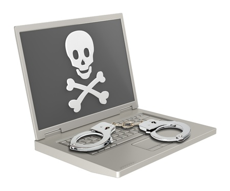 danger signs: Skull and crossbones on the laptop screen with handcuffs