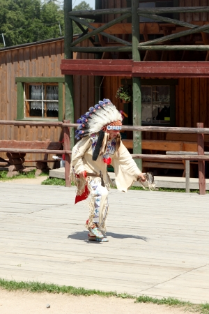 sioux: SCIEGNY, POLAND - JUNE 24: Sioux dancing ritual dance in Western City on June 24, 2012 in Sciegny, Poland. Western City is a replica of Wild West town located in Sciegny near Karpacz in Poland.