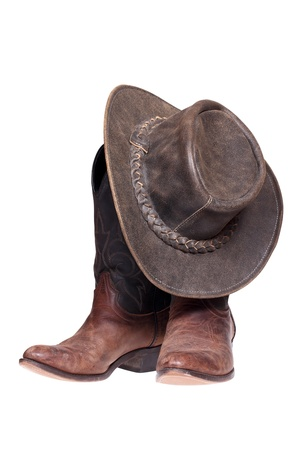 brown leather hat: Cowboy boots and hat isolated over white with clipping path Stock Photo