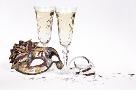 Masquerade mask and champagne isolated on white background
