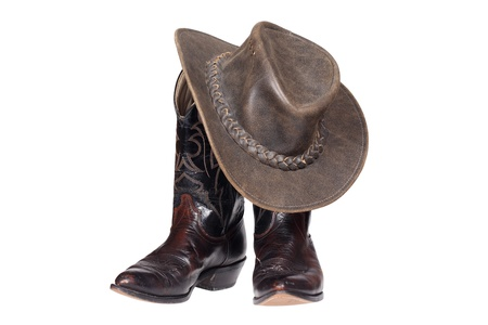 botas vaqueras: Las botas de vaquero y sombrero aislado con trazado de recorte Foto de archivo