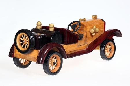 Wooden retro car isolated on white background photo