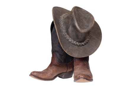 brown leather hat: Cowboy boots and hat isolated with clipping path
