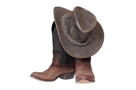 Cowboy laarzen en hoed geïsoleerd met clipping path Stockfoto