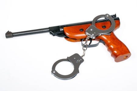 airgun: Airgun with handcuffs isolated over white, clipping path