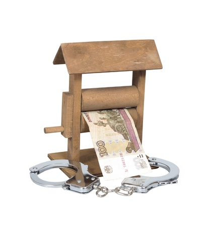 Money laundering  Rouble bill in the wringer with handcuffs isolated over white, clipping path included  photo