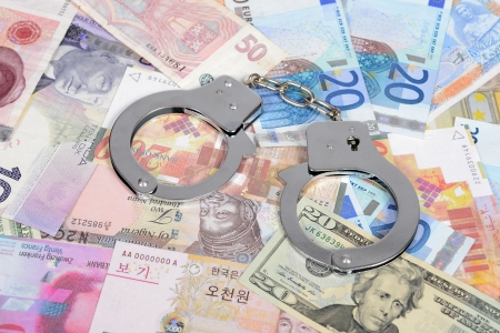 Currency from world with handcuffs photo