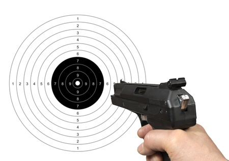 Hand holding gun shooting target with clipping path  photo