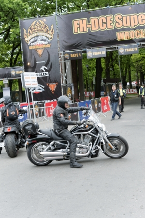 Wroclaw, Poland. Saturday 18th May 2013. Harley Davidson motorcycle riders in front of the gate 'Harley-Davidson Super Rally 2013'